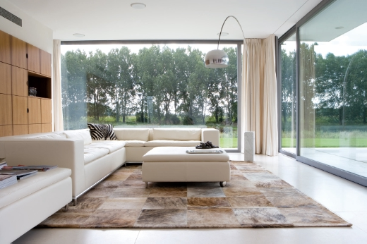 inspired flooring cowhide patchwork rugs the ace of space blog. Black Bedroom Furniture Sets. Home Design Ideas