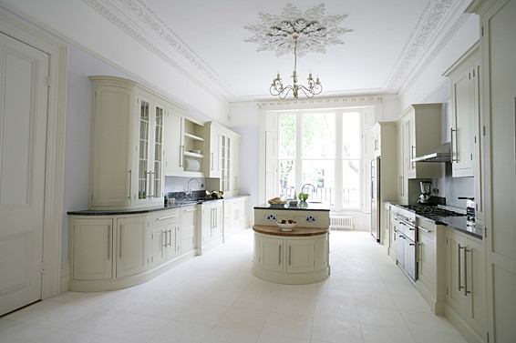 This historical property maintains it's architectural integrity while adding more current shaker style cabinets in this British bespoke kitchen.