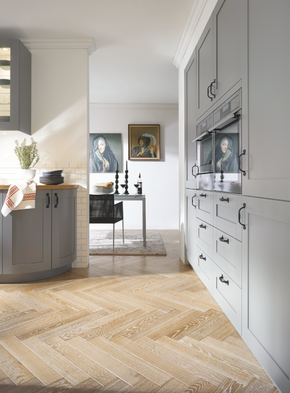 Shaker style cabinetry features more traditional rounded edges in this British bespoke kitchen.