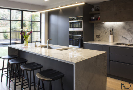 This classic open plan British bespoke kitchen design offers a discreet and smooth design with a modern twist