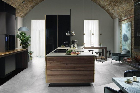 The blueprint of this British bespoke kitchen design is that of a historical kitchen, with the tall larder, plus a marble pastry bench with pot storage below in this bespoke kitchen.