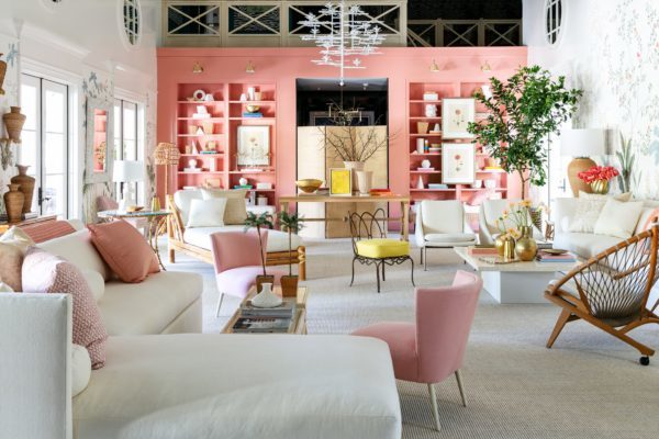 large indoor seating area with pink walls and floral wallpaper
